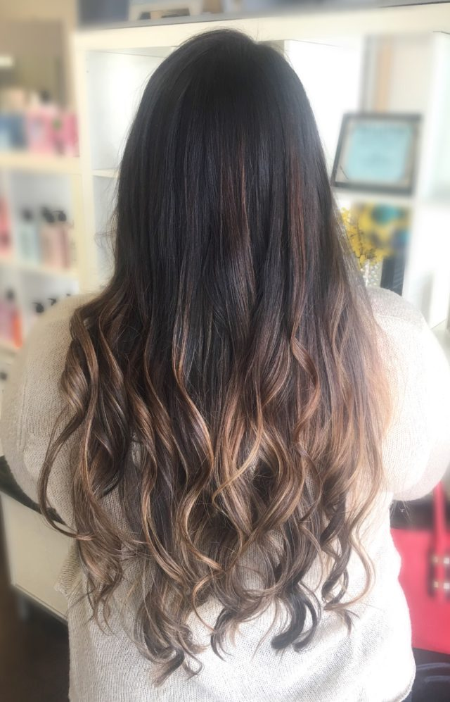 A rich and dark brunette base with pops of blonde and carmel flowing effortlessly through for a Natural Balayage. Rich Brunette Balayage by stylist Jessica Gossard of My Hair Therapy Sandy Luxury Hair Salon